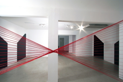 Karen Rifas. Red Torque, 2012. Polyester cord and drywall screws. Dimensions variable. Courtesy of Emerson Dorsch Gallery.
