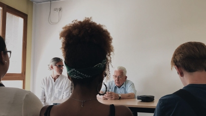 Claude Bloch recounts his WW2 story of surviving the Holocaust to the students of FIU. Professor Bailly translates for M. Bloch. at le Mémorial National de la prison de Montluc (Photo by Maria Delgado CC by 4.0)